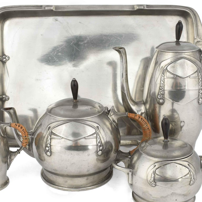 Jugendstil Centerpiece on Tray is an original decorative object realized in the 1905/1910.  The lot includes: one coffee pot, one tea pot, one cream server, one sugar bowl and one rectangular tray.  All the pieces are realized in silver plate.