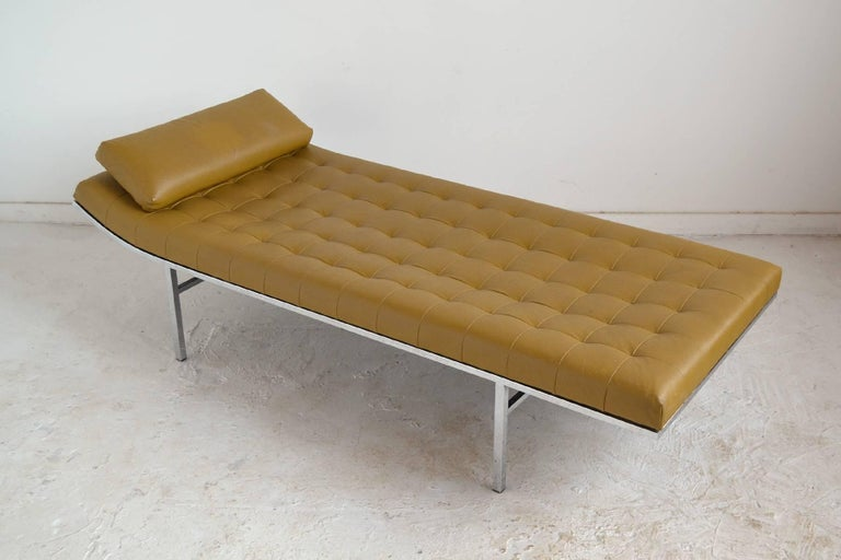 An elegant and extremely comfortable design, this chaise or daybed by Jules Heumann for Metropolitan has a long, low upholstered body with box tufting and a slightly raised end supported by a chromed steel frame. A loose cushion provides additional