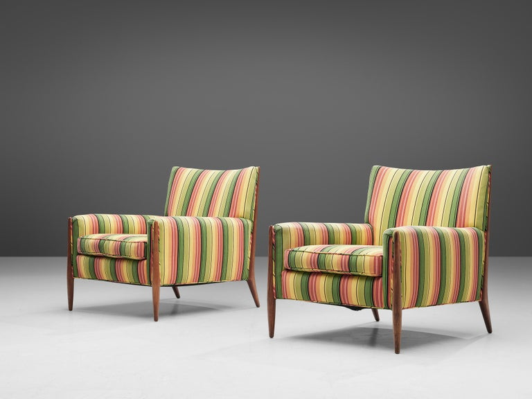 Jules Heumann, lounge chairs, colorful striped fabric, walnut, United States, 1960s  Classic midcentury lounge chairs by the American designer Jules Heumann for Metropolitan Furniture. Notable are the legs with rise high up and add a nice detail