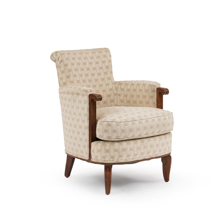 Pair of French Art Deco mahogany Bergère armchairs with beige geometric upholstery attributed to Jules Leleu.