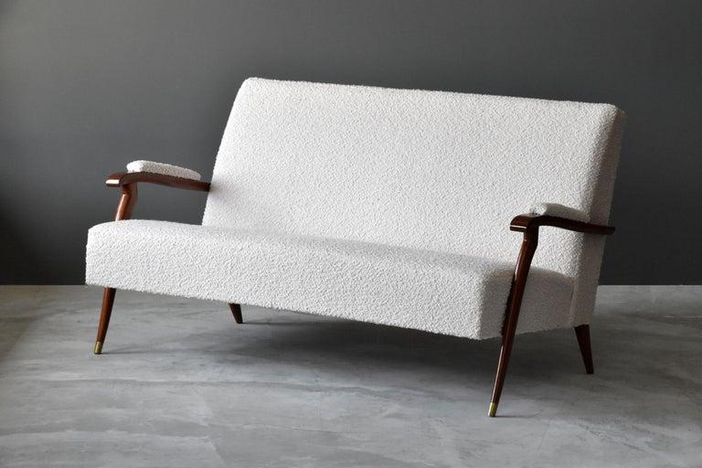 Mid-20th Century Jules Leleu, Modernist Settee, Mahogany, Brass, Bouclé, 1960s, France For Sale