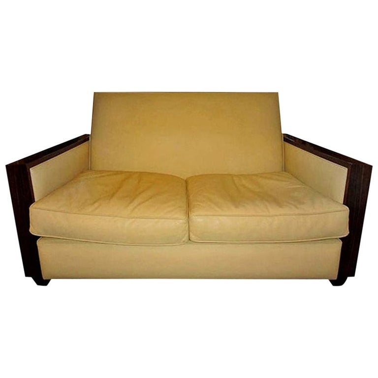 Stunning French Art Deco geometric leather upholstered Macassar loveseat, sofa or canapé in the manner of Jules Leleu or Émile-Jacques Ruhlmann. This comfortable French Art Moderne sofa is versatile and suitable for a variety of interiors. This