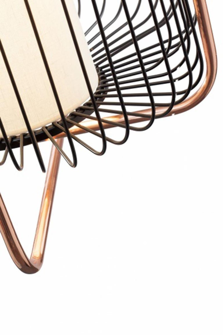 Jules is all about a timeless, effortless sophistication. A perfect combination of polished brass or copper with fun lacquered metal colors and a soft and elegant linen shade enclosed in the structure that softly diffuses the light. The structure is