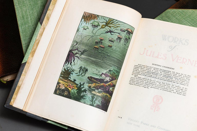 15 Volumes. Jules Verne. The Complete Works. Limited to 75 Sets, This is #6. Bound in 3/4 Green Morocco. (Spines Faded to Tan)Cloth boards, top edges gilt, raised bands, edited by Charles F. Horne. Illustrated, Hand colored frontispiece, signed