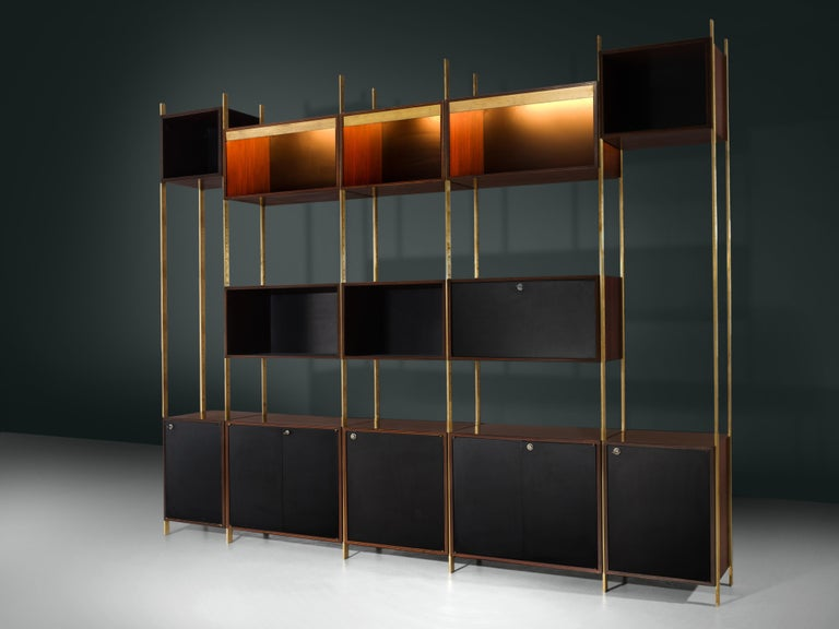 Jules Wabbes for Mobilier Universel, bookcase, in brass and rosewood, Belgium, 1960s   Rare wall unit designed by master furniture-maker Jules Wabbes. This exceptional piece could be used as a bookcase infront of a wall or a room divider. The