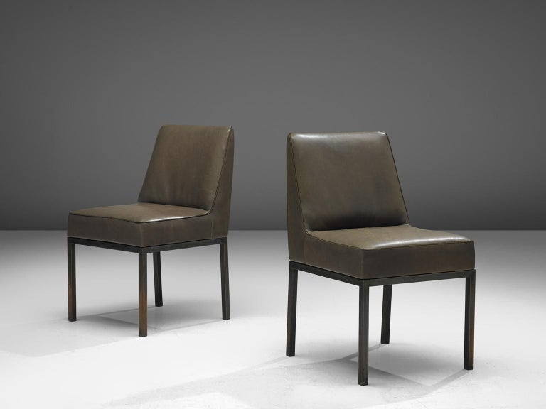 Jules Wabbes for Le Mobilier Universel, pair of side chairs model 'JJW 48', leather, chromium-plated metal, Belgium, c. 1963.  These modest and timeless chairs are designed by the well known Belgian designer Jules Wabbes. The dining chairs feature a