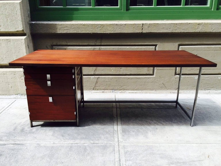 Rosewood and solid chromed steel frame desk by Jules Wabbes, manufactured by Mobilier Universal. Industrial desk. Each handle is marked Wabbes.