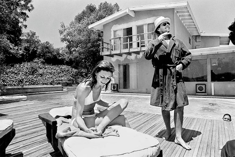 Julian Wasser Black and White Photograph - Jack Nicholson and Anjelica Huston by the pool, 1974