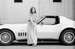 Joan Didion in front of her Stingray Corvette, 1968