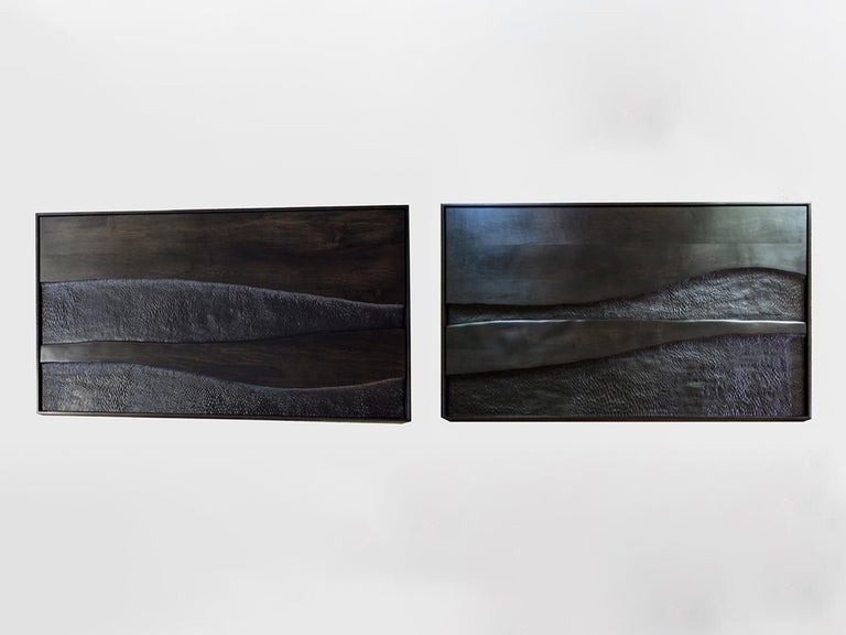 Pair of hand carved paintings by Oregon Based artist Julian Watts made of maple stained with black India ink and framed in maple wood. Each painting measures 42 × 72 × 3 inches. Sold as a pair. Currently on view at Patrick Parrish Gallery in Julian