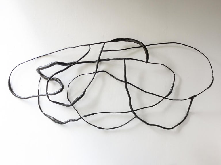 Hand carved wall hanging sculpture made of eucalyptus branches stained with black India ink. Currently on view at Patrick Parrish Gallery in Julian Watt's second solo exhibition with the gallery,