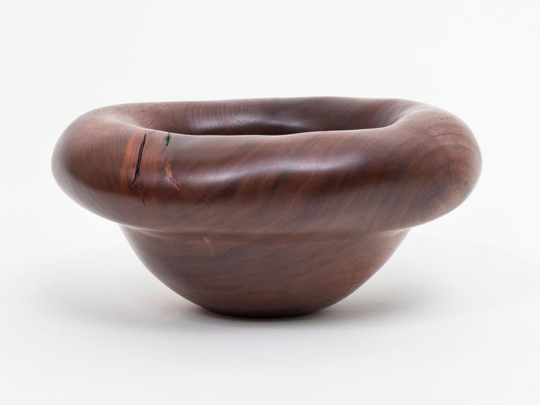 Hand carved walnut bowl sculpture by Oregon based artist Julian Watts.  Julian Wattswas born and raised in San Francisco, and now lives and works in Alpine, OR. He has shown work internationally at the FOG Fair, Design Miami, The London Design