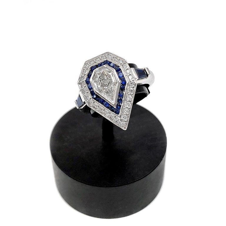One of a Kind Art Deco Inspired Ring handcrafted by  jewelry artist Julie Romanenko in 14k white gold featuring a bezel-set shimmering 0.60 carat fancy rose-cut kite-shaped diamond surrounded by 0.20 carats of blue sapphire pave, 0.14 carats diamond