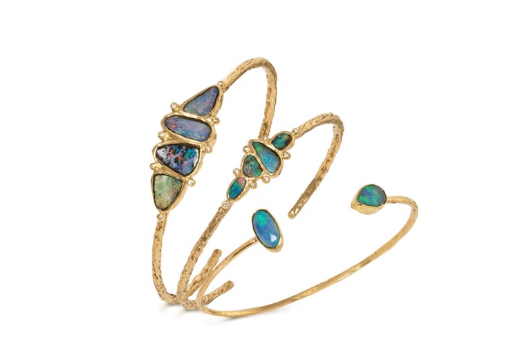 One of a Kind Cuff Bracelet handcrafted by  jewelry designer Julie Romanenko in intricately-textured 14k yellow gold showcasing four stunning boulder opals bezel-set and accented with 0.06 total carats of round brilliant-cut white diamonds. Signed