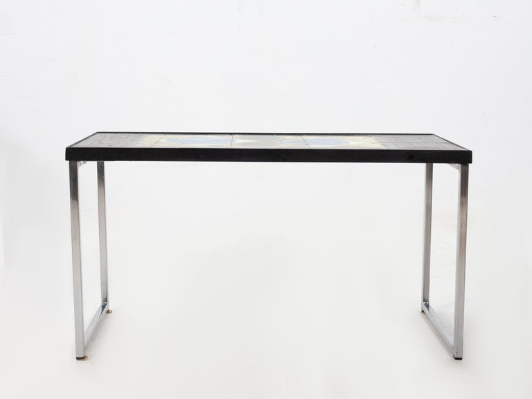Lovely side table Design by Juliette Belarti. Belgium 1960. Ten abstract hand painted tiles. Signed Belarti. Black steel rim, on chrome metal legs. A peace of art on your table top. Very good quality table. Excellent condition. Love this little
