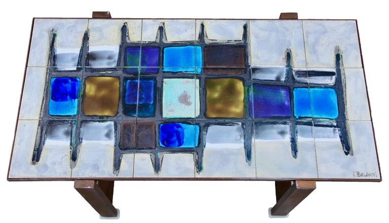 This iconic 1960s Belgian design has survived to become a collector's piece. A new generation of young ceramicists produced handcrafted tile-sets to fit a standardized table size. Dramatic colors could be unleashed, new surfaces and materials used,