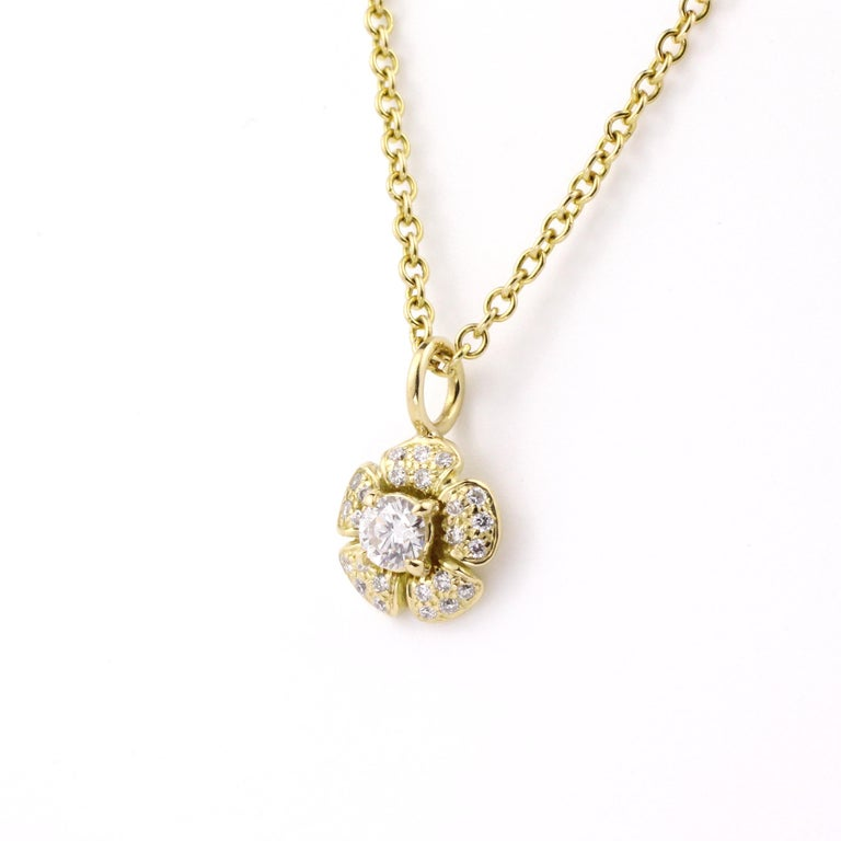 A classic Julius Cohen design, this sweet, single flower contains one .15 Ct. brilliant Diamond at its center surrounded by .25 Cts. of Diamond pave petals.    The flower pendant is also available in other stone colors.  Please email or call us for