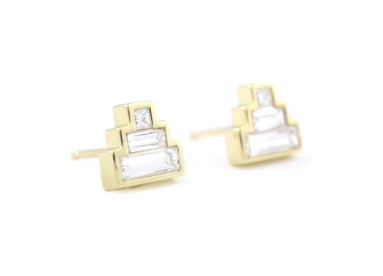18 Kt Yellow Gold and Diamond Earrings  These stepped, stud earrings each contain a Princess cut and two Baguette Diamonds of slightly different lengths.  1.02 Total Carat weight for the pair.    Designed and Made in-house by Julius Cohen New York.
