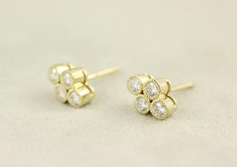 These 18 Kt Yellow Gold and Diamond Stud Earrings contain 8 Brilliant Cut Diamonds (.44 Cts.).  A perennial Julius Cohen favorite, these earrings can also accommodate drops.  Please email or call us to inquire about drop options and