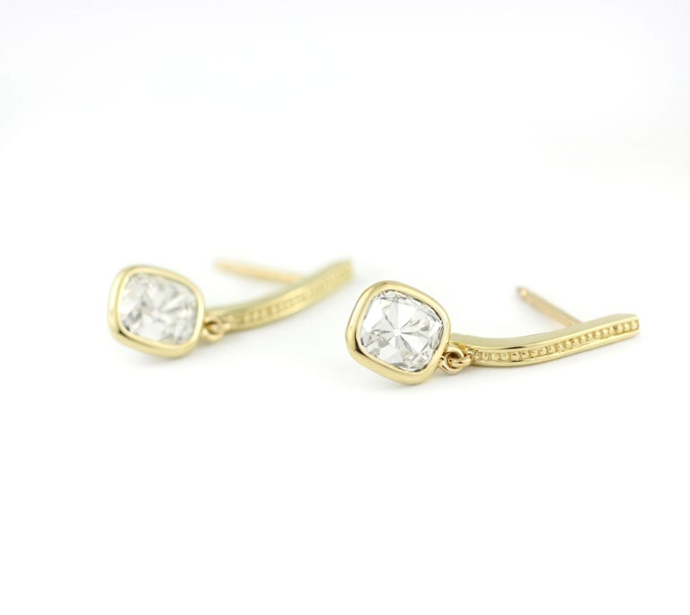 These earrings contain a beautiful vintage pair of Cushion Shape, Old Mine Diamonds, with each stone weighing just over 1.25 Cts.  (2.58 Cts. for the pair, Approx. H-I, VS).  The European cut of these old-miners are warm and charming, possessing a