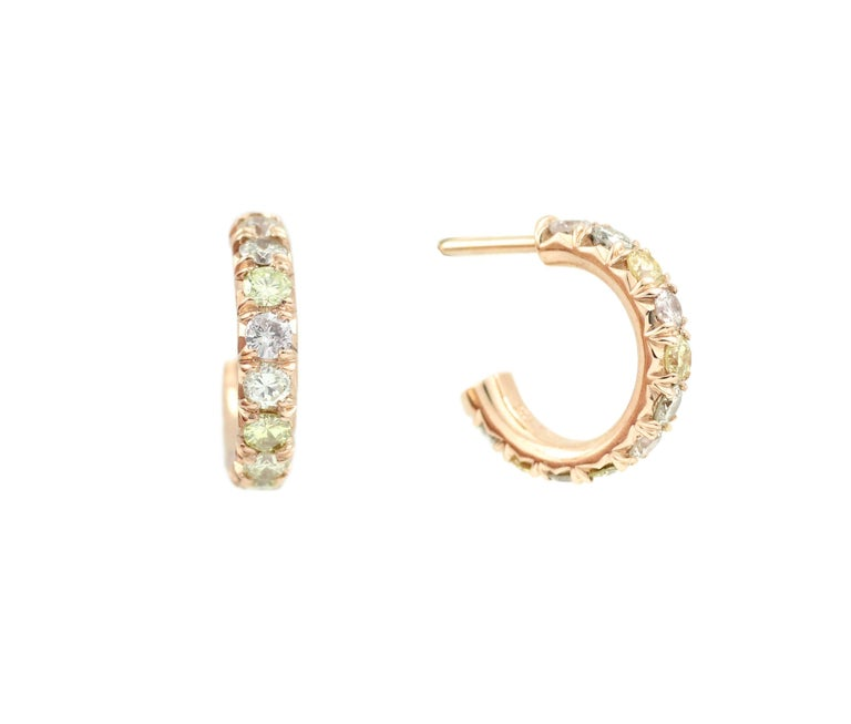 These hoop earrings contain 22 Natural Color, Brilliant Cut Diamonds (1.15 Cts.).   A beautiful, light color range of yellow, peach, gray and sand toned Diamonds are highlighted and complemented by the post-back, 18 Kt Rose Gold setttings.