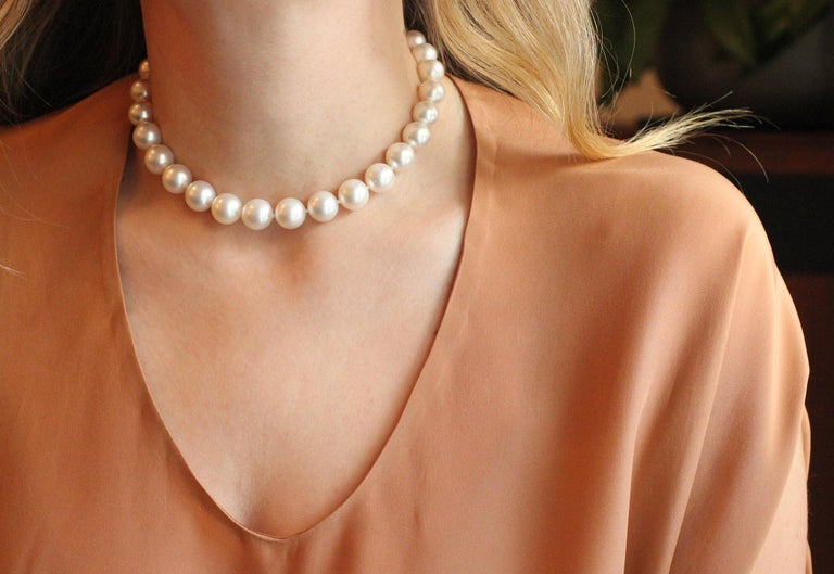 This fine pearl strand choker is gently graduated (pearls 10-12.5mm) and has a beautiful 18 Kt Gold and Diamond ball clasp closure (76 brilliant cut diamonds at 2.90 cts).