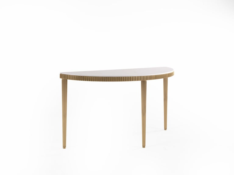 Console with the structure in brass. Top in lightened white marble. Dimensions: W. 151 x D. 46 x H. 82 cm.