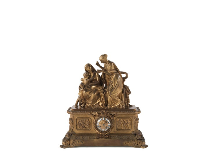 This important and fine ormolu clock was made in France towards 1860, according to the taste of the so-called Second Empire. The case is a typical quality bronze cast and gilt one, composed of a sculpted scene surmounting a decorated plinth where