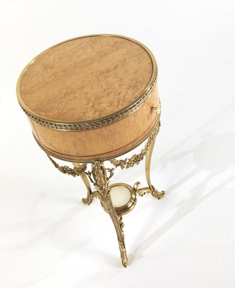 Jumbo Collection Pleasure nightstand in wood and brass base.  Materials: handcrafted brass base and wooden parts with decorated erable and gold finishing.  Dimensions: ø 41 x H. 73 cm.