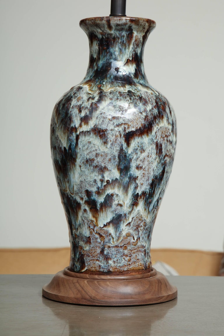 Antique Jun ware jar lamp conversion with hare's fur glaze and walnut turned accents.
