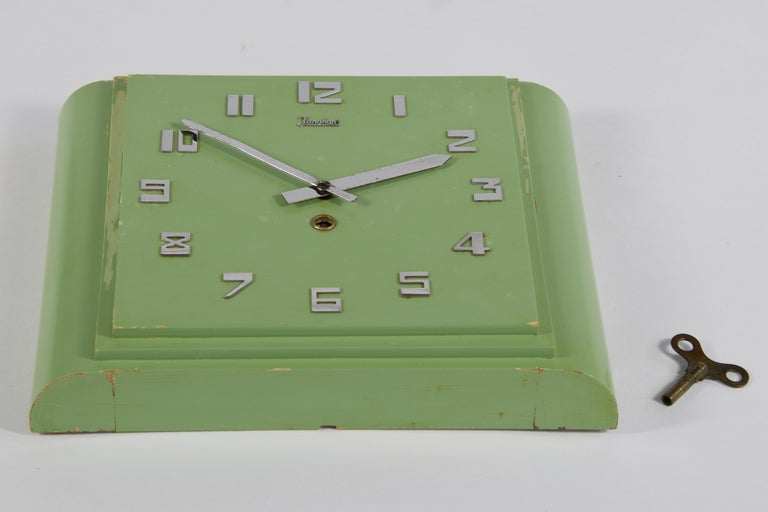 Funny mint colored wall clock made by Junghans, Germany. Art Deco shaped clock with wind-up key. Wooden case with show of wear and use.