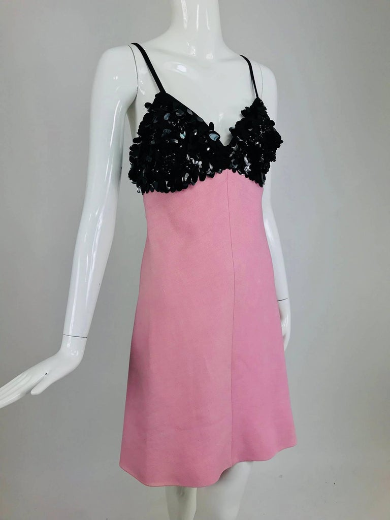 A Junior Sophisticates Original black paillette and pink linen dress and coat set from the 1960s designed by Anne Klein. Junior Sophisticates was started in 1948 by husband and wife Ben and Anne Klein, sophisticated designs for petite women in
