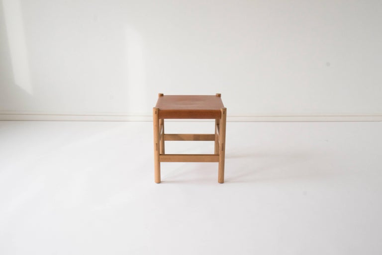 Sun at Six is a contemporary furniture design studio that works with traditional Chinese joinery masters to handcraft our pieces using traditional joinery. A simple, versatile stool. The vegetable tanned leather will patina with age. Exposed through