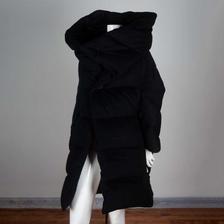 Junya Watanabe Comme des Garçons vintage archive 2004 warm winter coat from Japan in black cashmere, wool and down feather. Deconstructed style with large, dramatic collar that can be worn folded over the shoulders or up around the neck and head. A