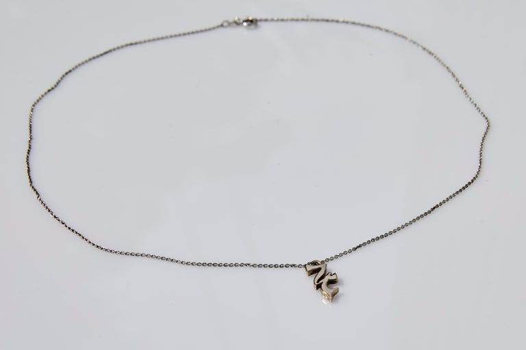 Jupiter Necklace  J DAUPHIN Necklace in silver with bronze pendant with Jupiter symbol  Available for immediate delivery  Hand made in Los Angeles  Made to order in Silver or Gold, Custom order takes 3-6 weeks to be completed. Price upon request