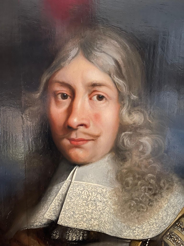 ATTRIBUTED TO OR FOLLOWER OF JÜRGEN OVENS (1623-1678)  Portrait of Rijcklof van Goens (1619-1682) in 1656 , 37 years of age  Oil on parqueted panel, 115 x 80 cm In gilt-wood carved Auricular style frame.  Note: Rijcklof was born in 1619 in Rees,