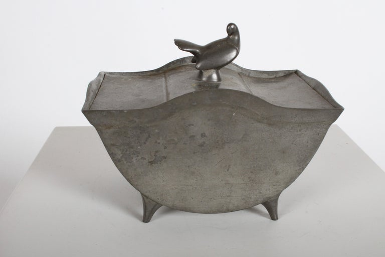 Sculptor Just Andersen Denmark designed covered box in pewter, footed form with curved sides and ornamental dove bird in repose on lid, stamped