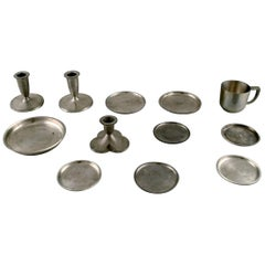 Just Andersen, Three Candlesticks, Eight Bottle Trays and a Mug in Pewter