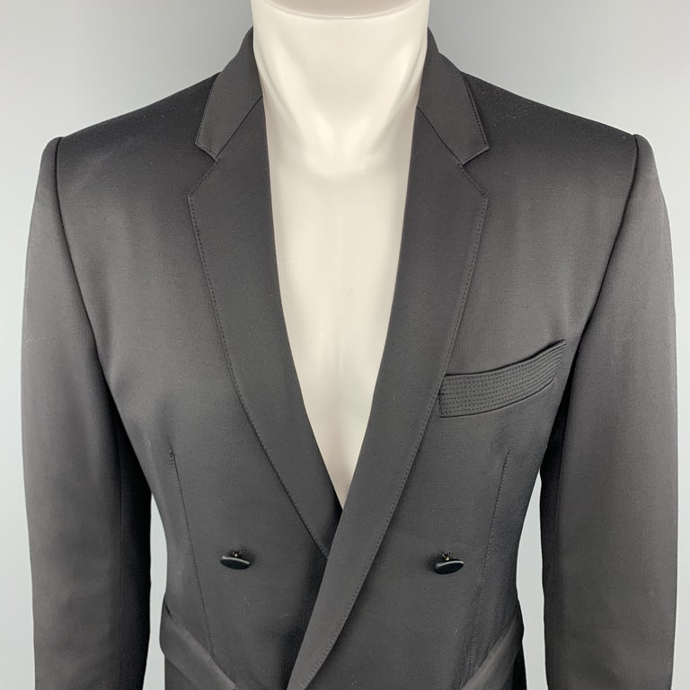 JUST CAVALLI Sport Coat comes in a black tone in a solid viscose blend material, with a notch lapel, slit and flap pockets, double breasted, buttoned cuffs, and a double vent at back. Made in Italy.  Excellent Good Pre-Owned Condition. Marked: IT