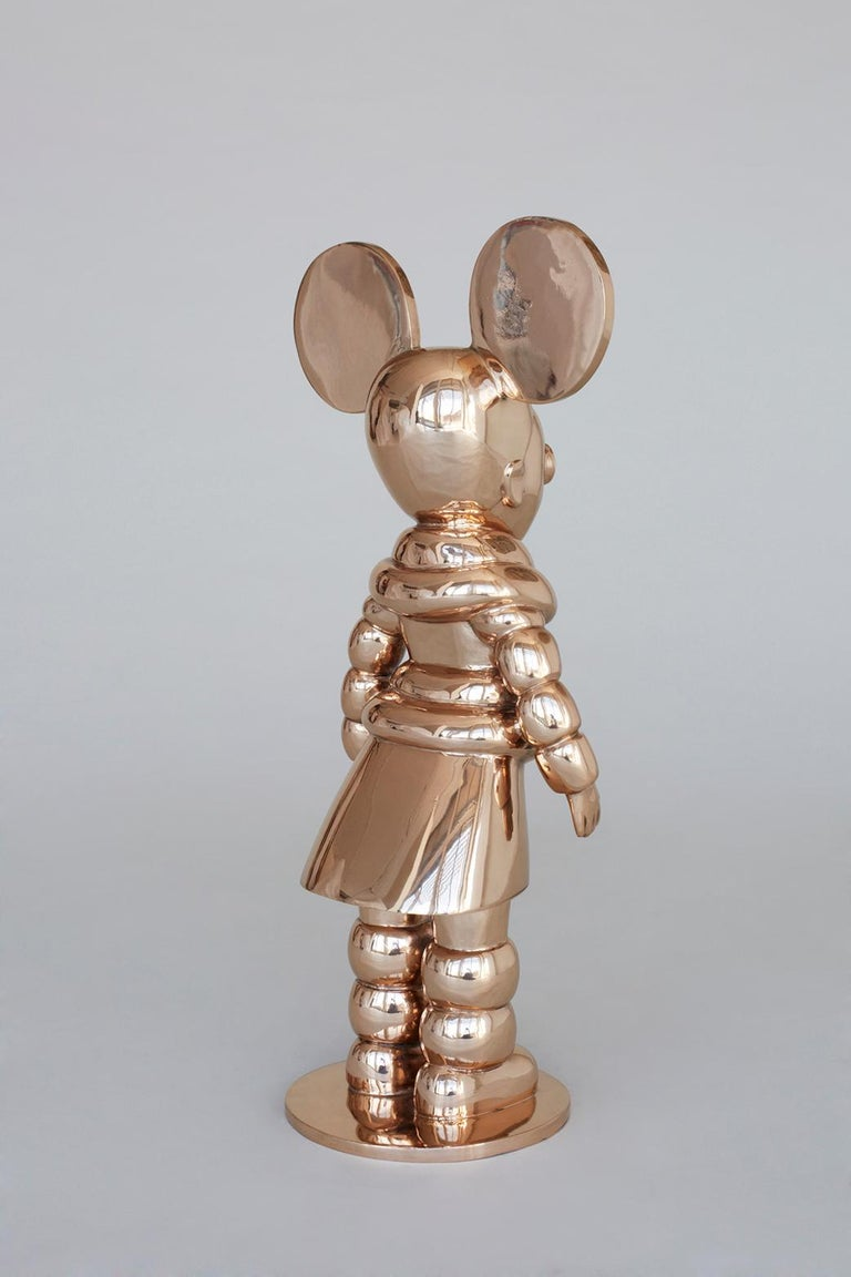 A special edition of Justine Mahoney's Mighty Ndebele sculpture, finished entirely in polished bronze. Mahoney's bronze figures represent the fears, nightmares, dreams and aspirations of children. These are based on stories told to their creator by