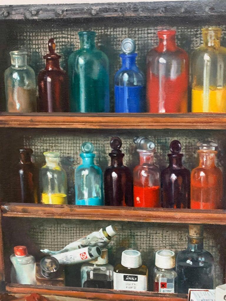 Artist Materials on Shelves - Painting by Justo Revilla
