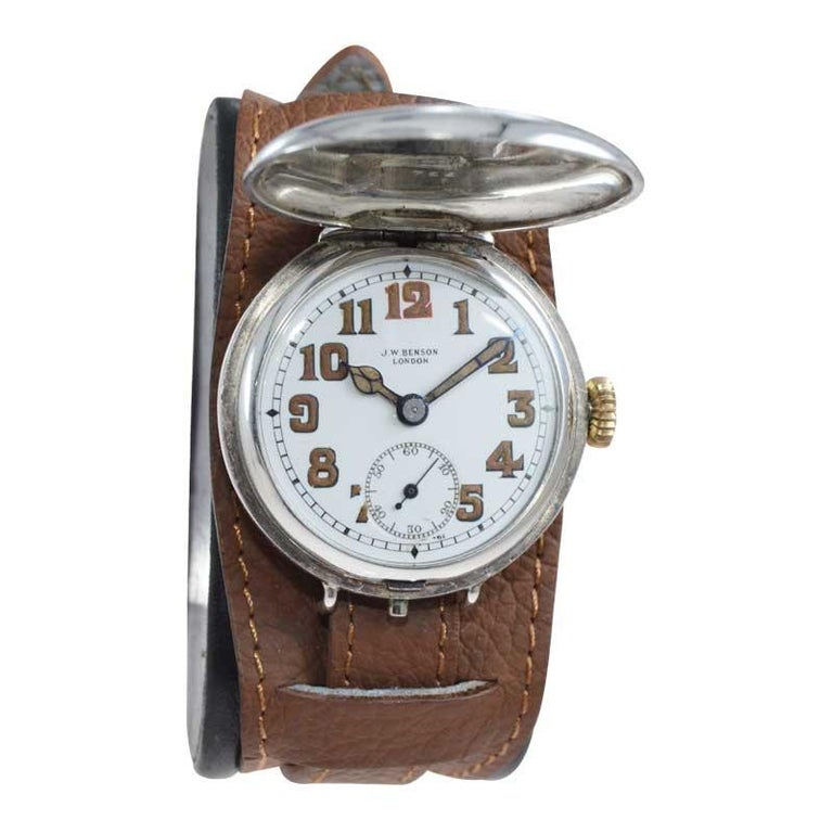 FACTORY / HOUSE: J.W. Benson Watch Co. STYLE / REFERENCE: Hunters Case / Military Style  METAL / MATERIAL: Silver CIRCA / YEAR: 1915 DIMENSIONS / SIZE: 39mm x 34mm MOVEMENT / CALIBER: Manual Winding / 15 Jewels  DIAL / HANDS: Original Kiln Fired