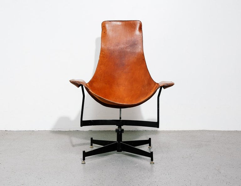 'K-Chair' leather sling chair designed by William Katavolos for Leathercraft, 1950s. Painted steel frame with swivel base.  Measure: 15.5