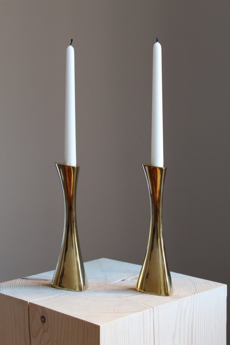 A pair of candlesticks. Designed by K-E Ytterberg, for Bca Eskilstuna, Sweden, circa 1950s. Stamped and initialed.
