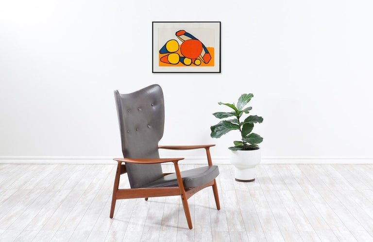 K. Rasmussen Leather and Teak Wingback Lounge Chair with Ottoman In Excellent Condition For Sale In Los Angeles, CA
