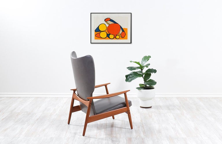 Mid-20th Century K. Rasmussen Leather and Teak Wingback Lounge Chair with Ottoman For Sale