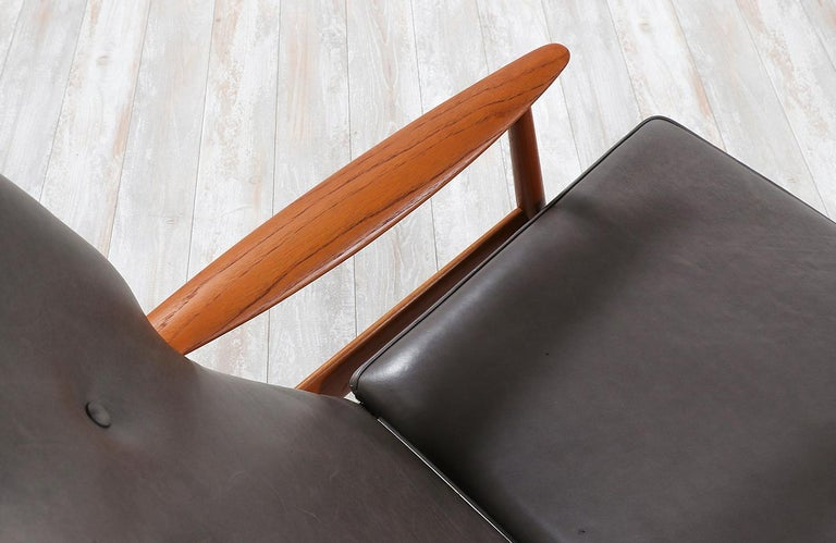 K. Rasmussen Leather and Teak Wingback Lounge Chair with Ottoman For Sale 1