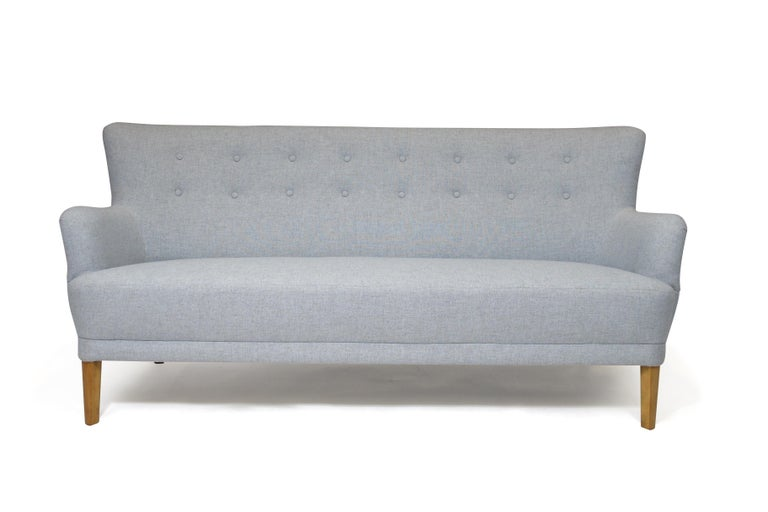Danish sofa designed by Kaare Klint, circa 1940, Denmark. Frame is handcrafted out of solid wood with dowled joinery, eight-way hand-tied copper spring seat, and padded with layers of horsehair and cotton for a comfortable yet supportive seat. Newly
