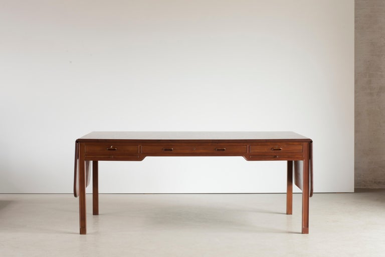 Kaare Klint freestanding desk of Cuban mahogany with two fold-down leaves. Executed by Rud. Rasmussen, 1930-1932.