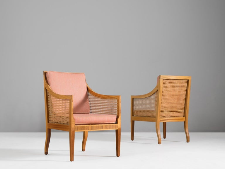 Kaare Klint for Rasmussen, set of two 4488 lounge chairs, mahogany, rosewood, cane and fabric, Denmark, design of 1931.